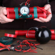 Hummakes timebomb on wooden table on black background — Stock Photo #17213423