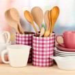 Cups, bowls nd other utensils in metal containers isolated on light background — Stock Photo
