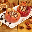 Baked apples on plate on wooden table — Stock Photo #17213771