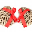 Wicker hearts with red bow isolated on white - Stock Photo