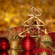 Christmas composition  with candles and decorations in red and gold colors on bright background — Stock Photo