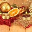 Christmas composition  with candles and decorations on wooden background — ストック写真