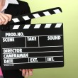 Movie production clapper board on color background - Stock Photo