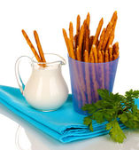 Tasty crispy sticks in purple plastic cup isolated on white — Stock Photo