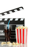 Movie clapperboard, cola and popcorn isolated on white — Stock Photo