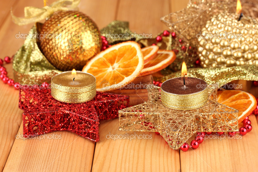 Christmas composition  with candles and decorations on wooden background — Stock Photo #17214073