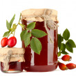 Jars with hip roses jam and ripe berries, isolated on white — Stock Photo #17383951