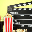 Movie clapperboard, cola and popcorn on background — Stock Photo