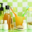 Bath accessories on shelf in bathroom on green tile wall background — ストック写真