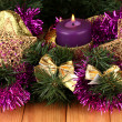 Christmas composition with candles and decorations in purple and gold colors on wooden background — Stock Photo #17386053