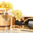 Stock Photo: Wooden case with wine bottle, barrel, wineglass and grape isolated on white