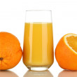 Royalty-Free Stock Photo: Delicious orange juice in glass and oranges next to it isolated on white