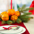 Beautiful christmas table setting with tangerines and fir tree, close up — Foto Stock