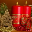 Two candles and christmas decorations, on brown background — Lizenzfreies Foto