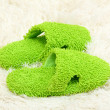 Bright slippers, on carpet background — Stock Photo