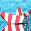 Stock Photo: Ship of Americflag, on blue background. Columbus Day.