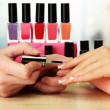 Manicure process in beauty salon, close up — Photo