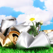 Stock Photo: Garbage with growing flower. Environmental conservation concept