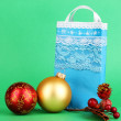 Christmas paper bag for gifts on green background — Photo