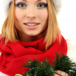 Attractive young woman holding Christmas wreath, isolated on white — Stock Photo