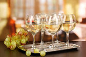 White wine in glass on room background — Stock Photo