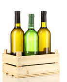 Wine bottles in wooden box isolated on white — Stock Photo
