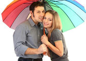 Loving couple with umbrella isolated on white — ストック写真