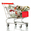 Stock Photo: Shopping trolley with dollars, isolated on white