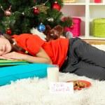 Little girl sleeping near christmas tree — Stock Photo #17593679