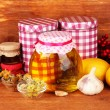 Honey and others natural medicine for winter flue, on wooden background - Photo