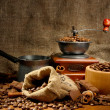 Coffee grinder, turk and cup of coffee on burlap background — Stock Photo