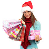Beautiful young woman with shopping bags and gifts, isolated on white — Stock Photo