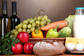 Composition with vegetables in wicker basket on brown background — Stock Photo