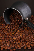 Coffee beans poured from turk — Stock Photo