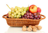 Grape in basket with nuts isolated on white — Stock Photo