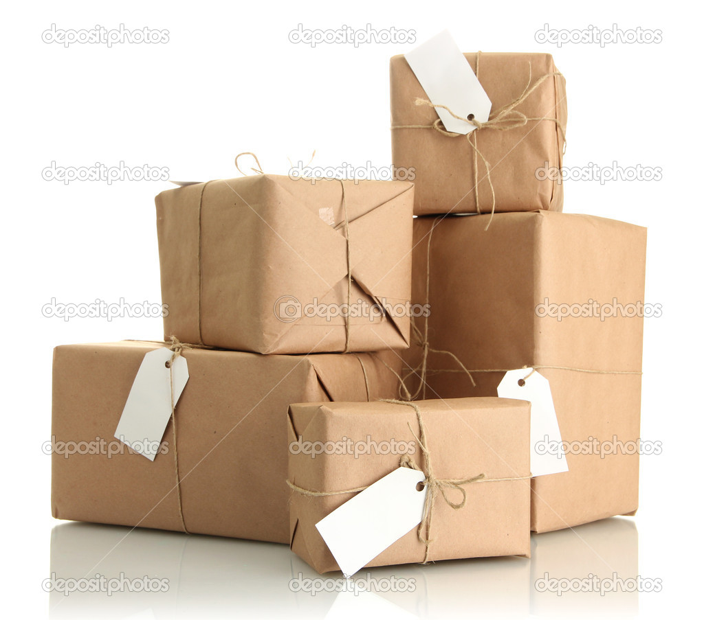 Parcels boxes with kraft paper, isolated on white — Stock Photo #17594157