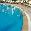 Hotel swimming pool with sunny reflections - 图库照片