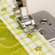 Closeup of sewing machine working part with green cloth — Stock Photo #17619595