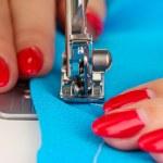 Hand sewing on machine — Stock Photo
