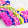 Children's mittens in snow — Lizenzfreies Foto