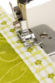 Closeup of sewing machine working part with green cloth — Stock Photo