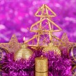 Christmas composition  with candles and decorations in purple and gold colors on bright background - 图库照片