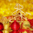 Christmas composition  with candles and decorations in red and gold colors on bright background - Lizenzfreies Foto