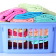 Plastic basket with bright towels isolated on white - Stock Photo