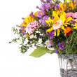 Beautiful bouquet of bright flowers in basket isolated on white - Foto de Stock  