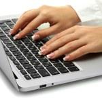 Female hands writing on laptot, close up — Stock Photo
