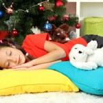 Little girl sleeping near christmas tree — Stock Photo #17639251