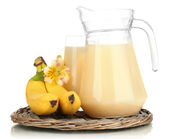 Full glass and jug of banana juice and bananas isolated on white — Stock Photo