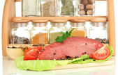 Raw beef meat with spices closeup — Stock Photo