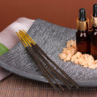 Aromatherapy setting on brown background - Stock Photo